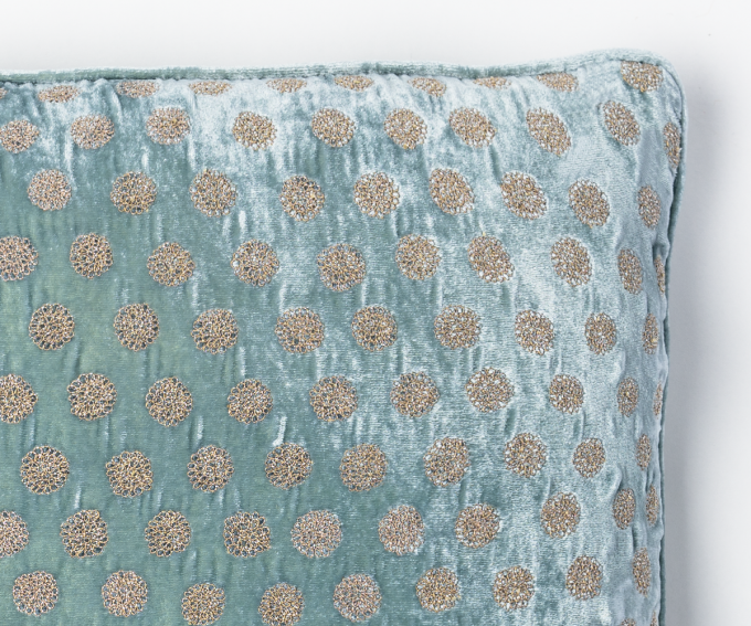 Detail of light blue silk velvet cushion with dotted pattern. 45mm x 45mm