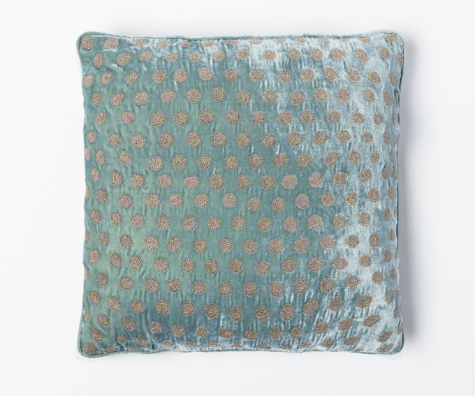 Light blue silk velvet cushion with dotted pattern.