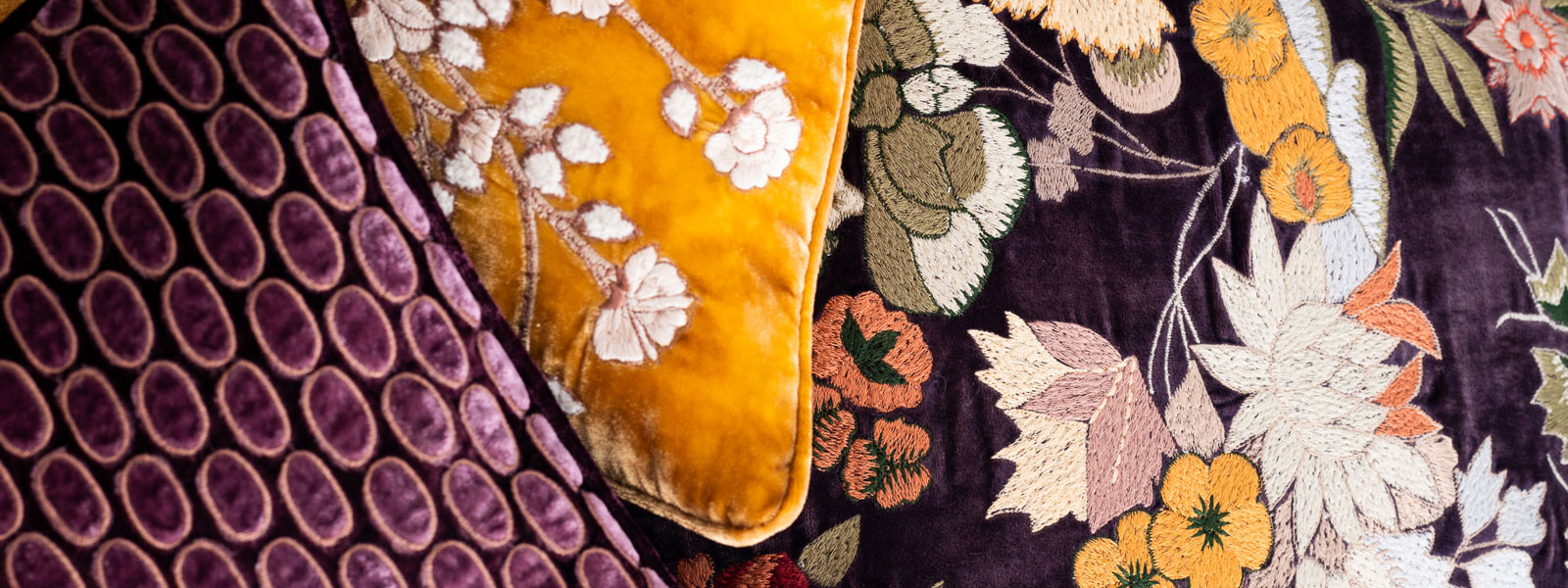 Collection of gold and purple cushions at Donna Hoyle Design